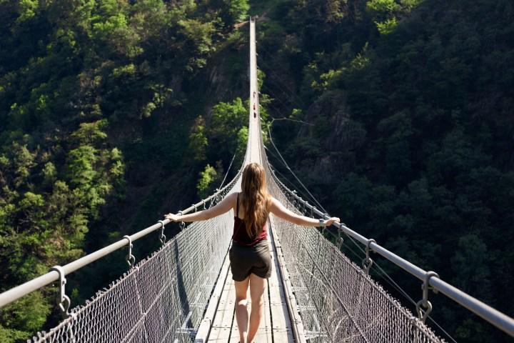 TIBETAN BRIDGE, WOMAN
